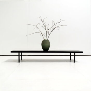 vintage black metal table with contemporary architecture